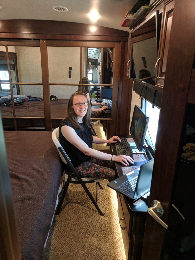 Picture of Christine sitting in the RV office
