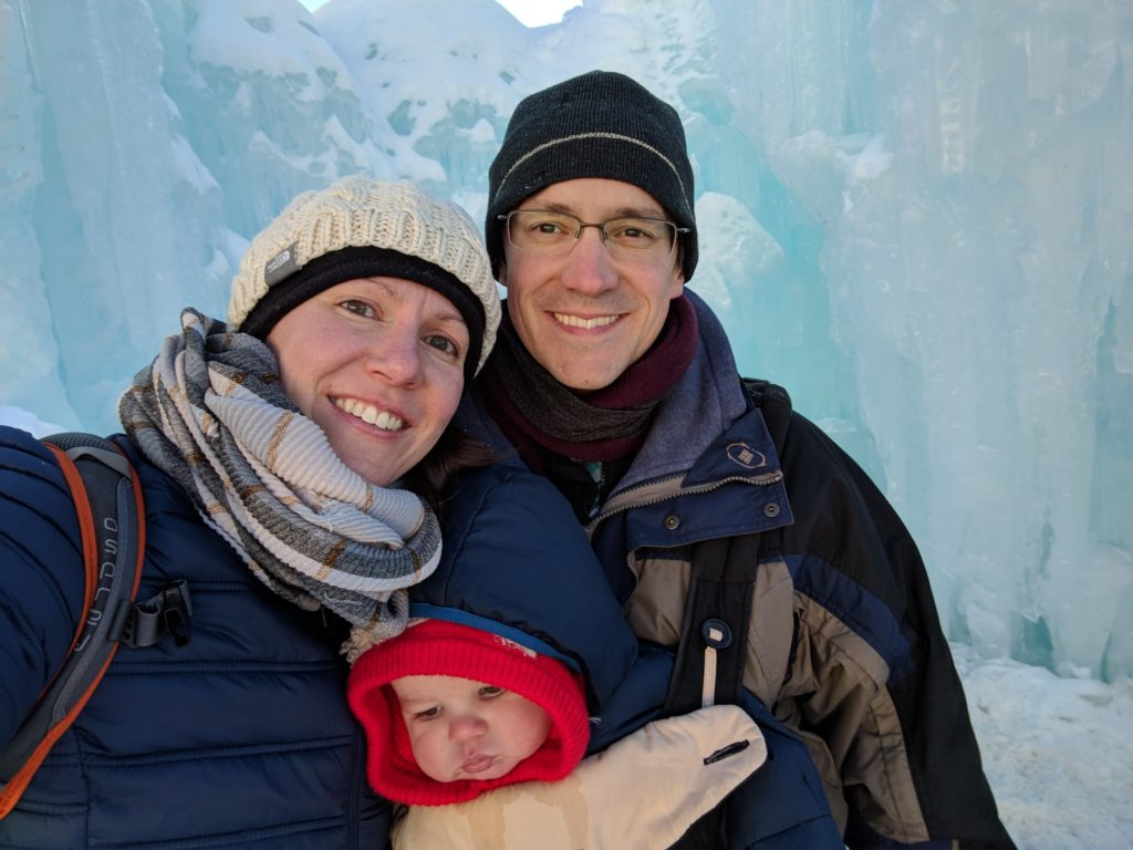Christine, Kevin & N in front of an ice wall