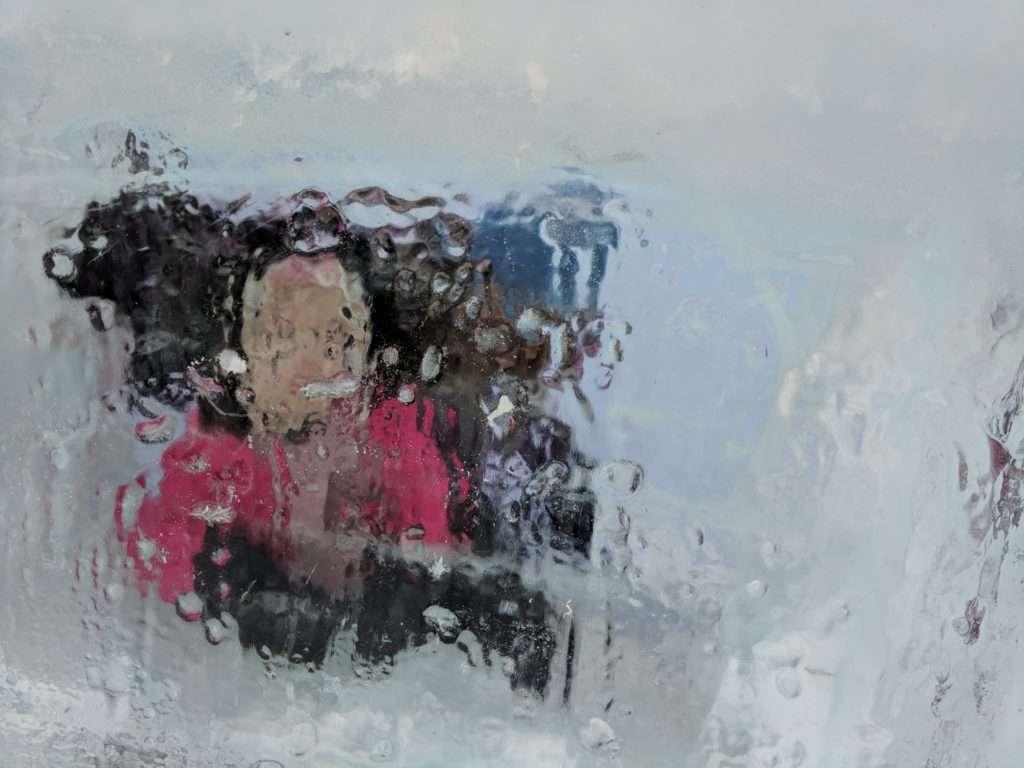 K & Michele behind an ice window