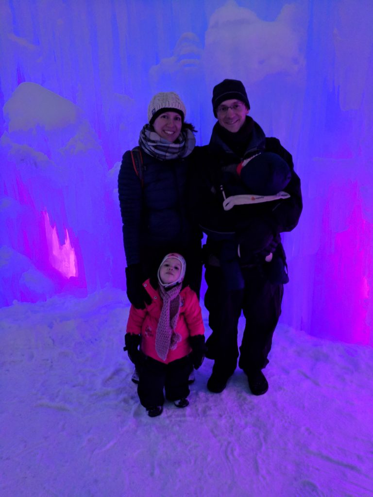 Our family in front of a wall lit by blue and pink light