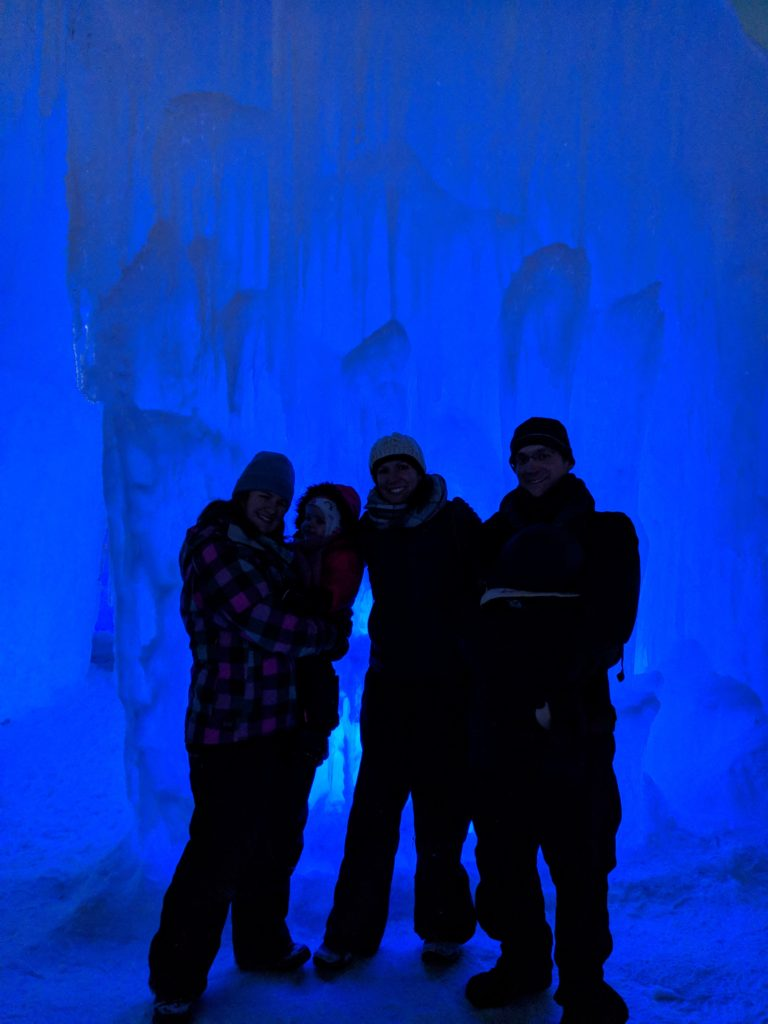 Our group in front of a wall lit by blue light
