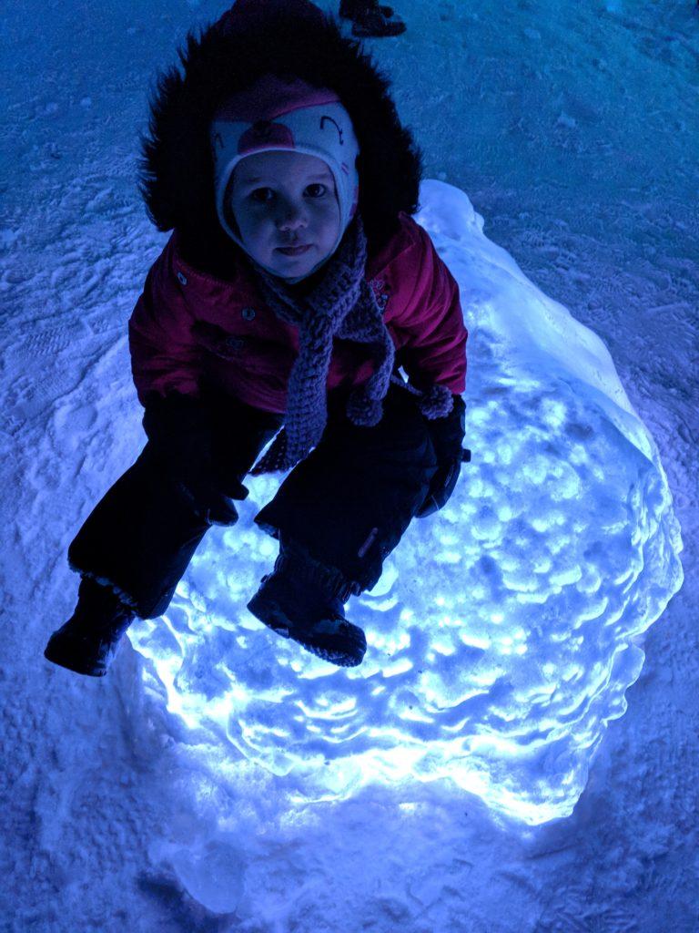 K sitting on an illuminated ball of ice