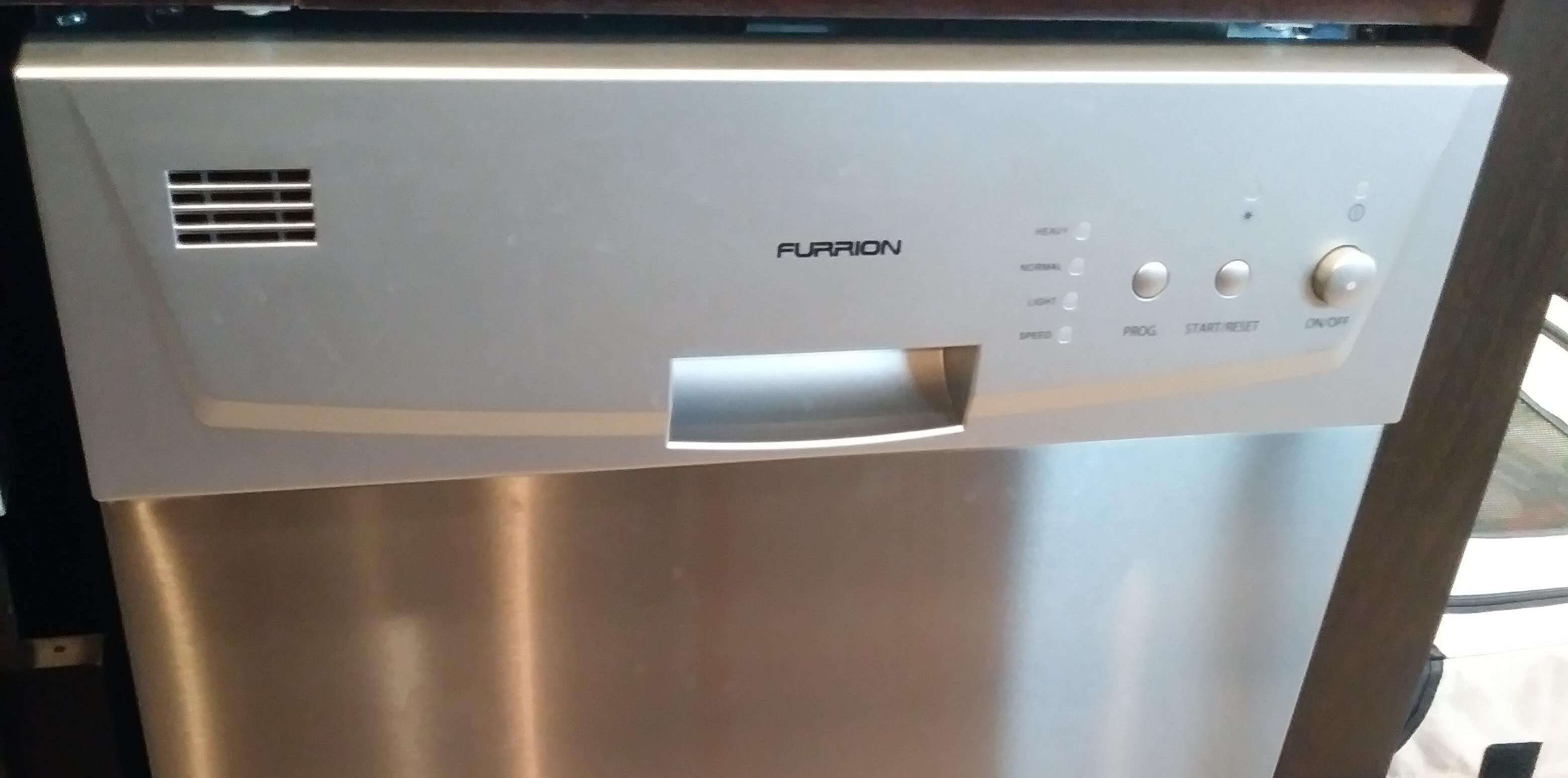 The front panel of an RV dishwasher