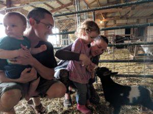 K feeding a baby goat