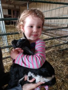 K holding a baby goat