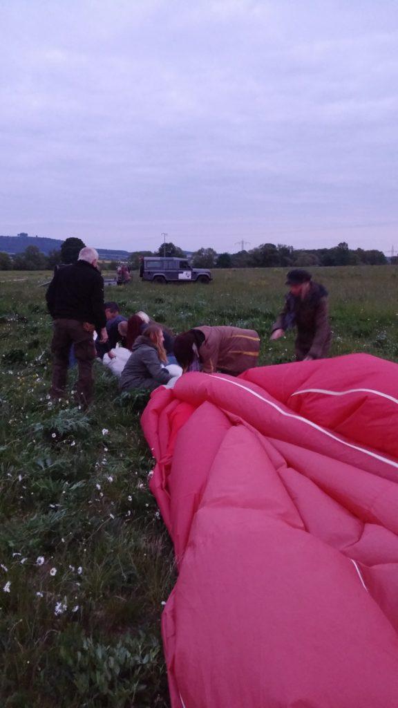 Folding up the hot air balloon