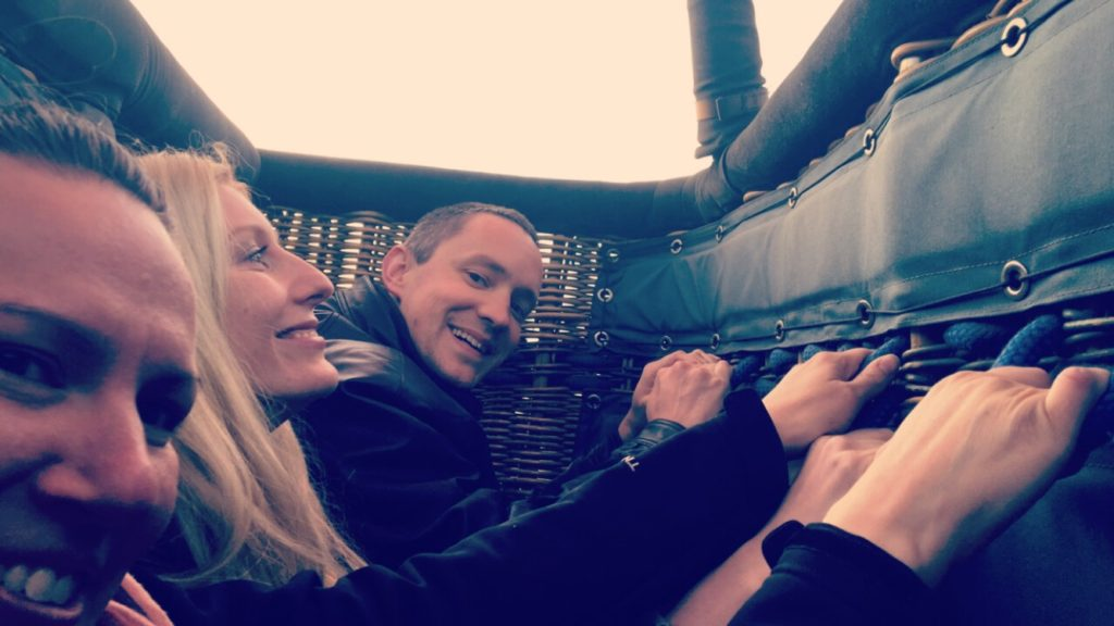 Passengers crouching down inside the basket at launch