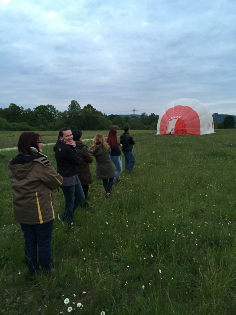 Pulling on the rope to start deflating the balloon