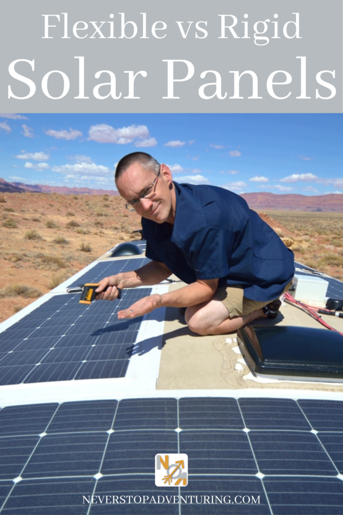 Man on roof of RV checking flexible solar panels for hotspots