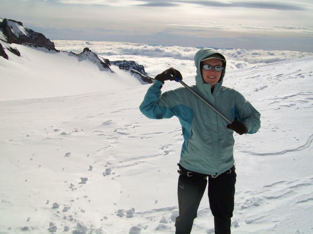 Christine with ice axe during Mount Rainier climb