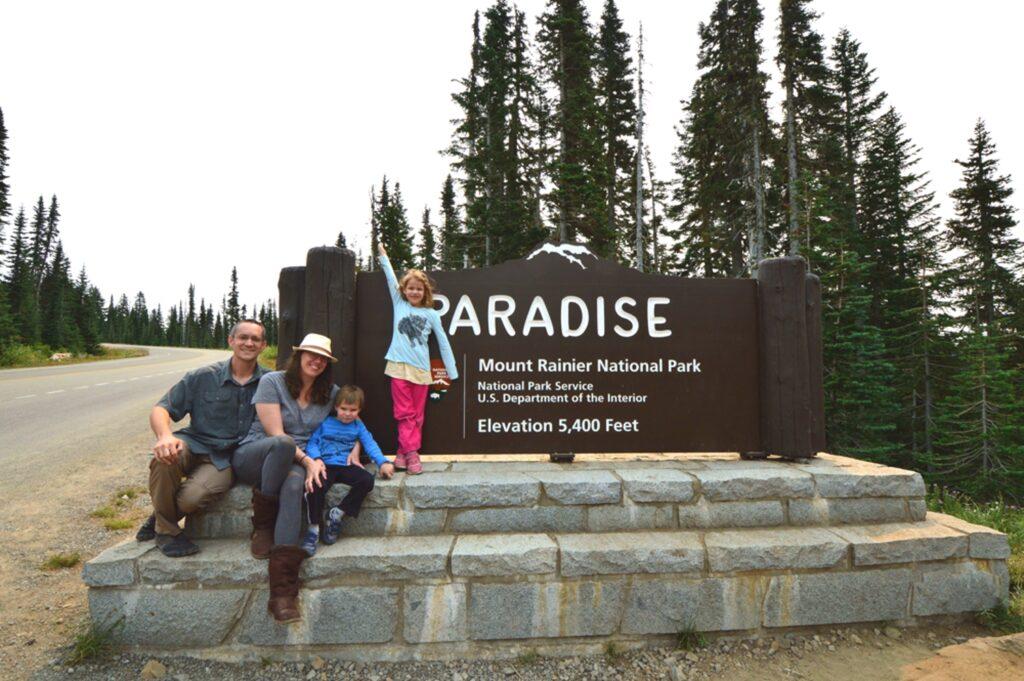 Family at Paradise sign